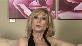 Nicole ray has fire in her eyes as she gets her labia tongue fucked by lesbian nina hartley