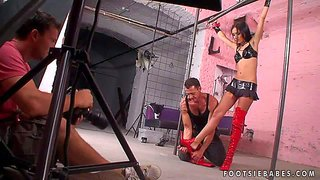 Gorgeous brunette pornstar sasha rose gets tied up and dressed in a latex clothes and rammed hard by horny lad from behind in front of the camera